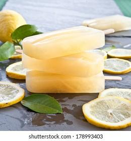 Fresh lemon popsicles on slices of organic lemons