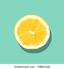Fresh lemon slice close up on bright blue background. Flat lay. Summer concept.