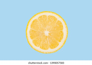 Fresh lemon slice on pastel blue background