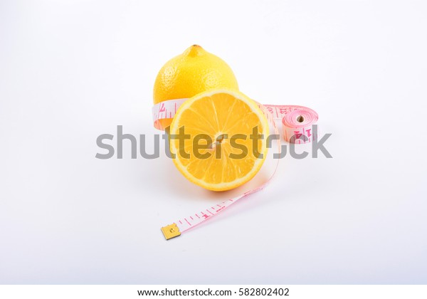 Fresh lemon, lemon slice and tape on white background.