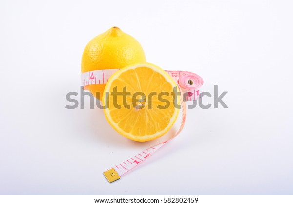 Fresh lemon, lemon slice and tape on white background.