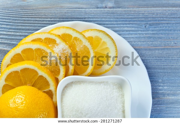 Fresh lemon with sugar on  white plate
