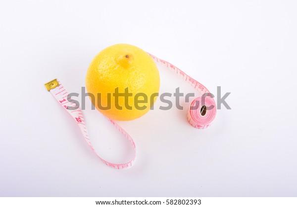 Fresh lemon and tape on white background