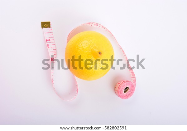 Fresh lemon and tape on white background