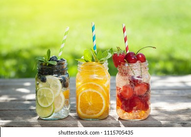 Fresh lemonade jar with summer fruits and berries