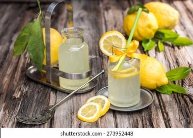 Fresh lemonade made of famous amalfi lemons on the old wooden board