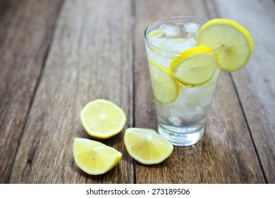 fresh lemonade and soda in a glass on a wooden table