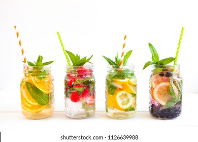 Fresh lemonade with summer fruits and berries on white background