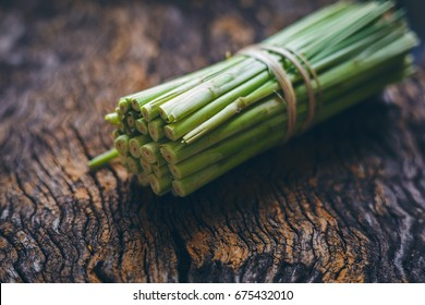 Fresh lemongrass (citronella) on wooden background - Spice for health.