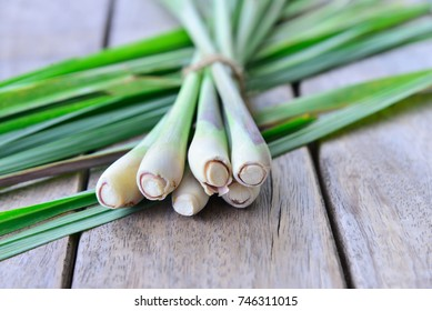 Fresh lemongrass  on wooden texture in cooking concept.
