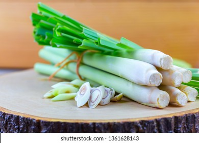 Fresh lemongrass rope and lemongrass slice on wooden cutting board in cooking concept.