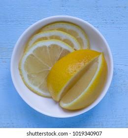 Fresh lemons on a blue background.