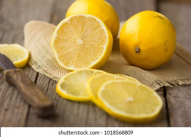 fresh lemons on the brown wooden table.