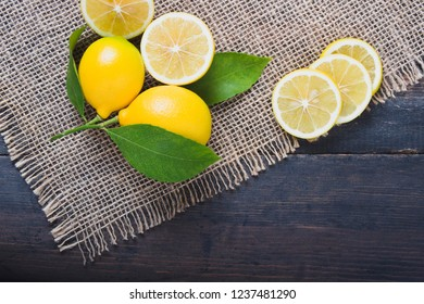 fresh lemons on the brown wooden table.