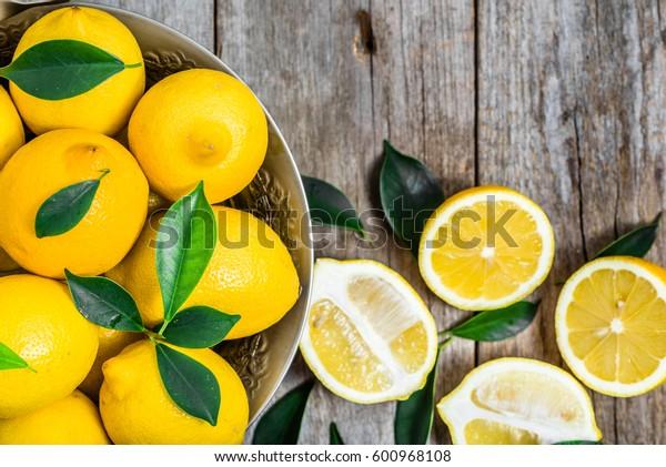 Fresh lemons on market table, top view