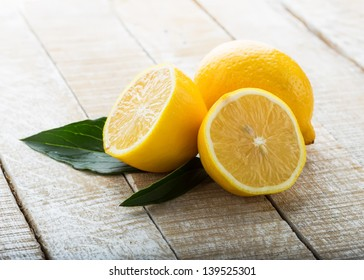Fresh lemons on wooden background. Selective focus.