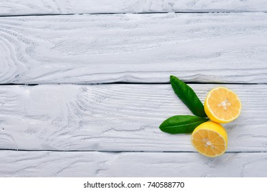 Fresh lemons. On a wooden background. Top view. Free space for your text.