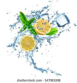 Fresh lemons in water splash over white background