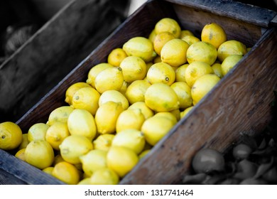 Fresh lemons in a wooden crate