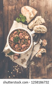 fresh lentil stew with sausages and parsley