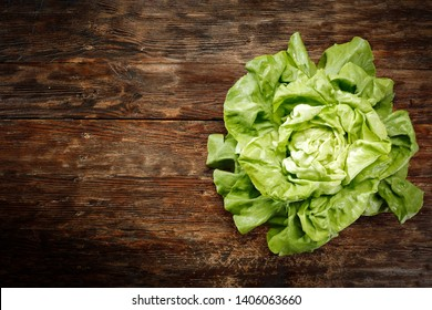 Fresh lettuce on wooden desk and free space for your decoration. Aerial photo