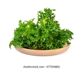 fresh lettuce on wooden plate