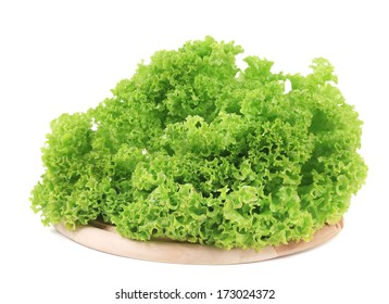 Fresh lettuce on wooden platter. Isolated on a white background.