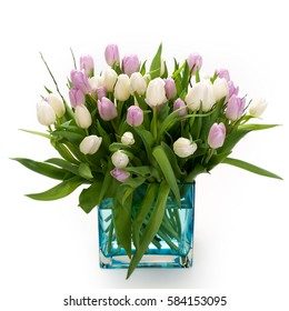 Fresh lila and white tulips in a vase