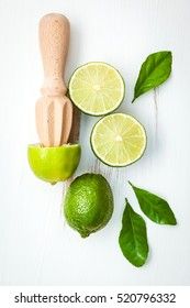 Fresh lime with citrus juicer stick. Preparation ingredient for cooking with lime. Making lime juice,easy and tasty refreshing drink that quenches thirst well on a hot day.lime juice cocktail recipes.