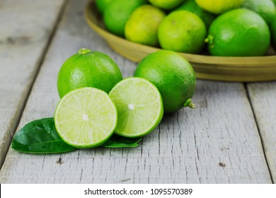 Fresh lime on tray and the old wooden floor.