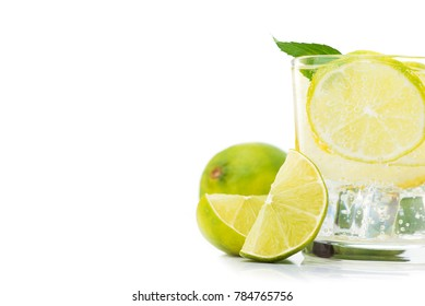 fresh lime water in glass isolated on white background. Refreshment and cooling beverage