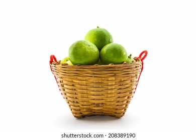 Fresh limes in basket on white background.