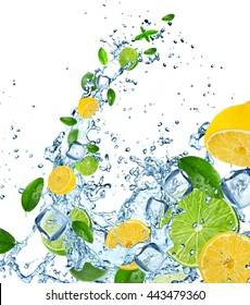 Fresh limes and lemons in water splash over white background
