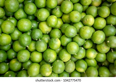 Fresh Limes or Limons for sale at Sunday Market in Ecuador