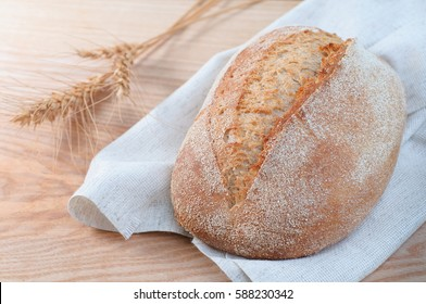 Fresh loaf of bread. Close-up view