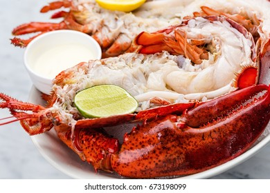 Fresh lobster with sauce and lime