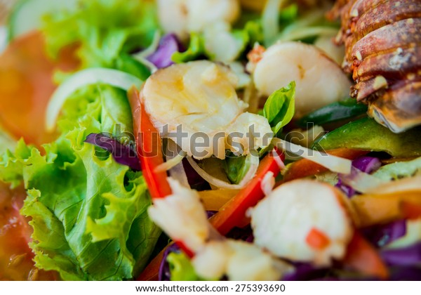 Fresh lobster with seafood sald. Restaurant