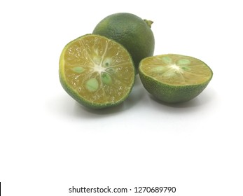 Fresh local calamansi or limau kasturi (citrus microcarpa) on white background.