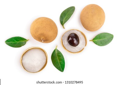 Fresh longan fruit with leaves isolated on white background. Top view. Flat lay