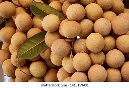 Fresh longan fruit on the market. close up details of longan fruit or kelengkeng fruit.