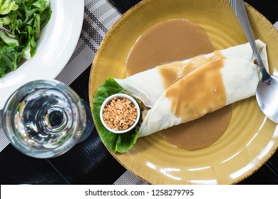 fresh lumpia or mixed minced steamed vegetable in sweet peanut sauce