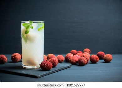 Fresh lychee mojito on the rustic background. Selective focus. Shallow depth of field.