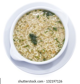 Fresh made Alphabet Soup with herbs isolated on white background