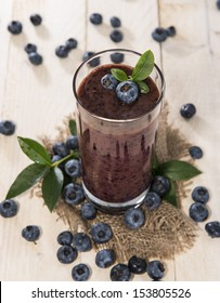 Fresh made Blueberry Smoothie on wooden background