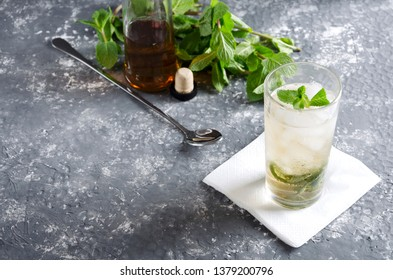 Fresh made delicious mint julep served on the grey bar table.Empty space for your text