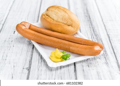 Fresh made German Sausages (Wiener) on a vintage background (close-up shot)