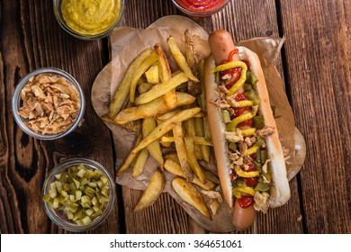 Fresh made Hot Dog (close-up whot) with fried onions and cucumbers