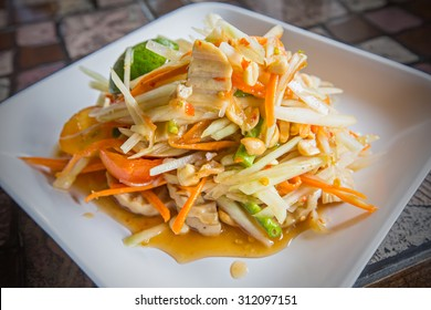 Fresh made hot papaya salad Som Tam with bean, carrot and peanuts. Traditional thai cuisine.