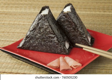 Fresh made Japanese onigiri packed in seaweed on a dish