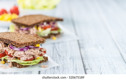 Fresh made Tuna sandwich with wholemeal bread (selective focus; close-up shot)